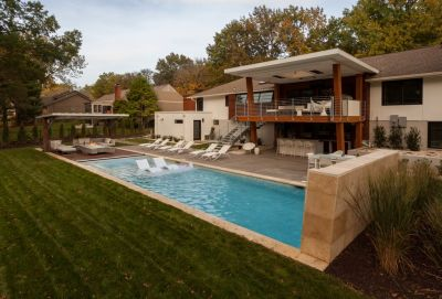 The inside of the client's home reflected her refined style sense, but the outside, well, not so much.  That led Kurt Kraisinger to pursue a path that transformed her humdrum suburban backyard into a sleek Contemporary showpiece -- one with a subtly nautical presence.