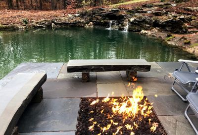 Fire adds a contrasting element to the quiescent water, a perfect place for coffee and a book, or a glass of wine and good conversation.