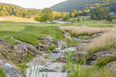 Asked to install a 1,200-foot-long steam/waterfall system for the final hole of a high-end golf course, Tim Krzeminski applied his consummate stream-crafting skill -- and what he learned in local hikes -- to produce a gorgeous water hazard any duffer would be happy to avoid.