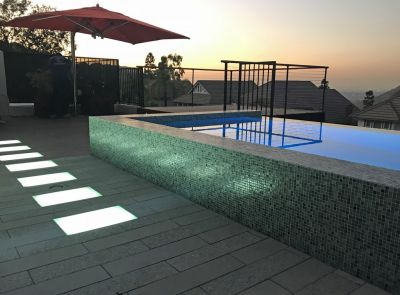 The homeowners had waited decades to revamp their backyard and came to the project with high expectations about how their new spa, fountain and deck would look.  Now it was up to Grant Smith to solve a few tricky technical issues while making the most of the distant views.