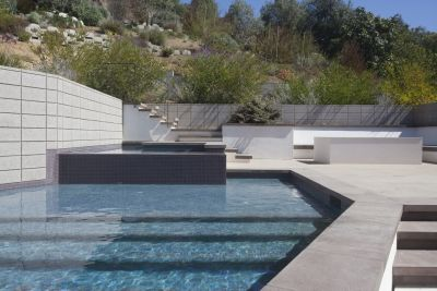 This beautiful, ultra-contemporary southern California project featured a number of shapely features designed to harmonize with the home's architecture. For Kevin Cobabe, it was an opportunity to apply his skills as a design-facing builder who can handle complicated equipment sets as well as the fine artistic touches.