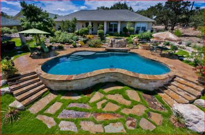 Fusing hardscape elements with grass is a beautiful way to harmonize the watershape areas with the surrounding landscape.