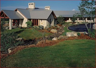 We often use the spoils from pool excavations to create gentle contours in grass areas and planting beds, blending the built landscape with the natural topography of the Texas hill country.