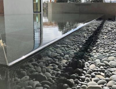 Turning his attention to a reflecting pool after completing two other watershapes on the same property, Steve Swanson suggested using a detail that was new to him.  This bold move involved him directly in the home's overall visual impact and in a high-stakes learning curve.