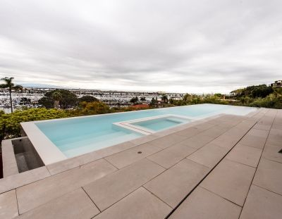 It was a challenging site for a long pool that would overflow on all four sides.  But with the right foundation and a well-engineered shell, writes Grant Smith, the project came together beautifully -- although it apparently wasn't enough to get his clients to stick around to enjoy the view!