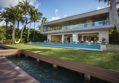 When the owner of this spec house wanted something truly unique, the design prepared by Brian Van Bower met the mark on all levels, creating an elongated waterfront jewel that perfectly complements a stylish home.