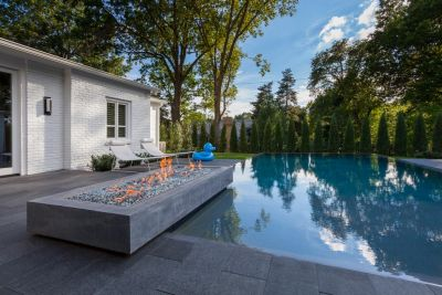 It was a Mid-Century Modern home that needed the right poolscape:  That task was well within Kurt Kraisinger's design sweet spot, and he responded with a dramatic, low-slung vision complete with a fire feature, broad decks and a pizza oven -- not to mention a big, blue duck.
