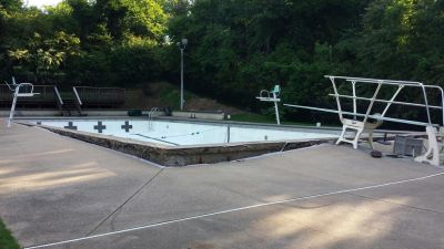 This wasn't one of those cases where a popped pool could be coaxed back into place.  Instead, Shane LeBlanc had to remove not just one, but two old shells -- and set up a new system while easing any fears city officials might have had about their watershape ever moving again.