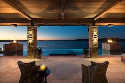 The position and basic shape of the pool may have been predetermined, writes Scott Cummings, but the visual drama he added with his finish selections and a perimeter-overflow/vanishing-edge design made all the difference in optimizing the site's cool water-on-water views.