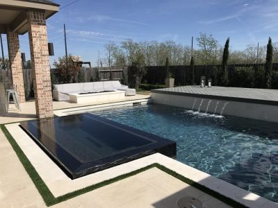 His clients were craving low-maintenance poolscapes, so Tanr Ross bucked convention and started using synthetic grass with some of his projects.  It's a solution he would have shot down a few years back -- but now, he says, it's part of almost every design discussion.