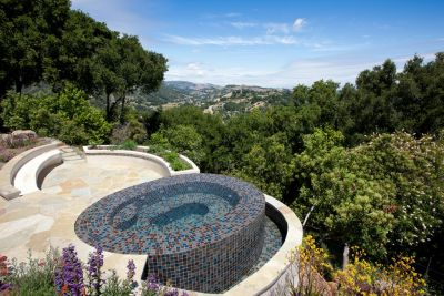It didn't take Paolo Benedetti long to notice that his prospective client's house was giving way on a slowly collapsing hilltop.  Armed with a fresh soils report, he designed a spa and stone deck that alleviated the slope's creeping -- and the homeowner's worries as well.