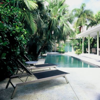 It's not often that a designer gets to return to a past project and update it for new owners.  But that was the opportunity Raymond Jungles was offered with this property -- a Mid-Century Modern showplace in the Florida Keys.