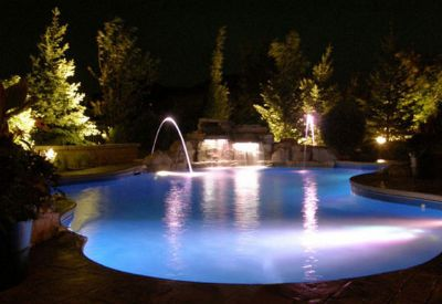 A crucial part of the backyard design process these days, writes Glen MacGillivray, is motivating homeowners to venture outside after dark.  Here's a look at how he approaches this day-to-night transition, from keeping the water moving to making it glow.
