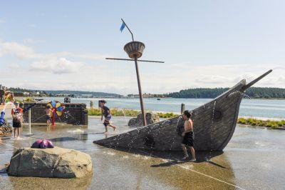 Part of a team that recently completed an intricate splash pad on the shores of Washington's scenic Puget Sound, Kent Walker guides a tour of a design centered on a faux shipwreck -- and its cargo of interactive features.