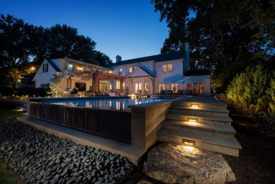 The clients wanted to add a pool to the existing features of their large backyard.  Kurt Kraisinger was happy to oblige, but he had a grander vision for reorganizing their entire space around a core fire feature and had to figure out a way to persuade them to come along for the ride.