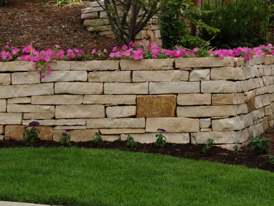 Whenever a landscape includes a retaining wall, says Chicago-based landscape designer Jerry Miraldi, it should be both functional and aesthetically pleasing as well.  In his case, however, personal circumstances have led him to broaden that basic rule, adding accessibility to the range of factors he considers in blending walls seamlessly into their landscapes.