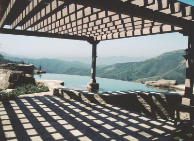 The customer wanted it all:  a large pool and spa made with natural materials; a fully-equipped outdoor entertainment area; a place to keep cool while lounging in the sunshine – all woven seamlessly into a work of watershaping art that took full advantage of a marvelously scenic location.  Here's a look at how designer/builder David Tisherman pulled all of the details into their dramatic final form.