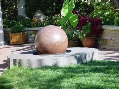 During the past decade or so, fountains that feature rotating granite balls have become familiar in myriad settings, from theme parks to upscale backyards.  The trick of floating weighty rock spheres on thin sheets of water in rounded sockets is actually a simple one, says fountain expert Anne Gunn, but it's nonetheless an effect that is utterly fascinating to children and adults who enjoy moving hugely heavy objects with the slightest of touches.