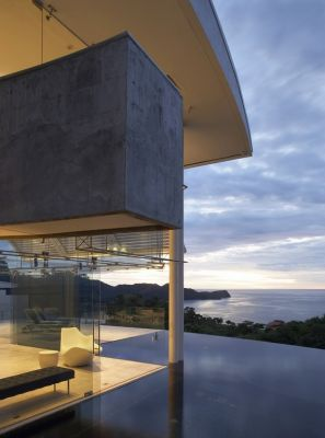 Set high on the bluffs overlooking Costa Rica's Pacific shoreline, this composition in water, tile and vanishing-edge drama at its most spectacular is his best work to date, asserts watershaper Juan Roca.  When it first appeared on the magazine's cover late last year, it was still under construction.  Now it is complete, he says, which leads him to share new images of his masterpiece in modern design and high-caliber watershaping.