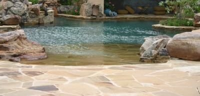 Any backyard project that encompasses tons of stone, hundreds of square feet of glass tile, a complex waterfall structure, a large bridge, an island spa and other features focused on fun, elegance and beauty is likely to be something special.  In this case, it happens to be one of master watershaper David Tisherman's most intricate achievements to date – one he guides us through in this pictorial, which captures the challenges as well as the glorious results of an enormous collaboration.