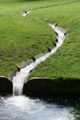 In his work as a landscape artist and custom watershaper, Robert Nonemaker often uses rills – small channels that simply and gracefully move water from one place to another – to bring interesting rhythms and harmonies to his garden spaces.  Although these features tend to be less than assertive, he notes, the way water moves through their narrow slots can do wonders when it comes to adding depth and detail to a watershape designs.